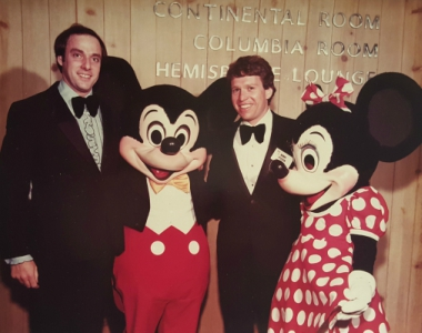 As their fathers did almost 20 years earlier at Disneyland, Jim (left) and Bob (right) celebrated sales success on an incentive trip at Walt Disney World